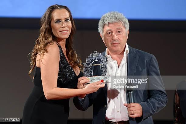 Barbara De Rossi and Antonio Catania attend the Awards Night At Teatro Antico during the 58th Taormina Film Fest on June 26 2012 in Taormina Italy