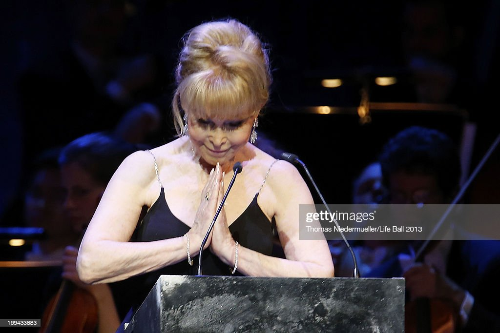 <a gi-track='captionPersonalityLinkClicked' href=/galleries/search?phrase=Barbara+Eden&family=editorial&specificpeople=206974 ng-click='$event.stopPropagation()'>Barbara Eden</a> speaks at the 'Red Ribbon Celebration Concert - United in Difference' at Burgtheater on May 24, 2013 in Vienna, Austria.