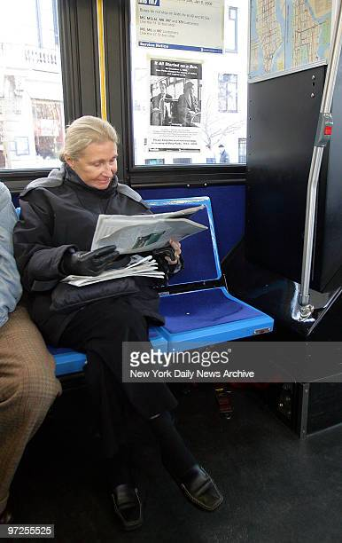 Barbara Gatje of Manhattan sits next to an empty seat at the front of the M1 bus over which a poster has been taped to the window to commemorate the...