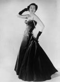 Barbara Goalen models an evening dress by Dior responsible for the 'New Look' after the austerity of Word War II