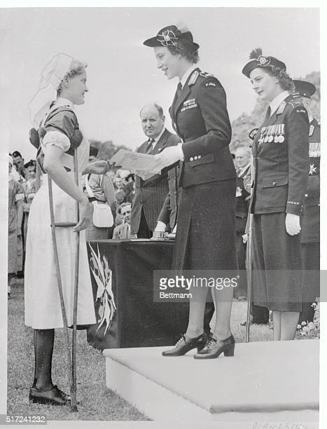 Barbara Goodyear of Heysham England receives a certificate of merit from Britain's Princess Margaret during a parade and review of some 7000 St John...