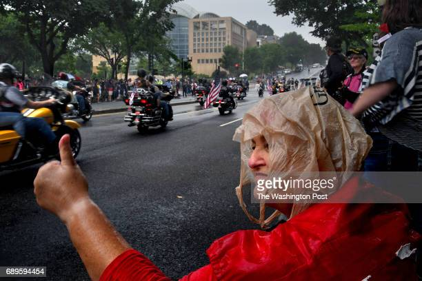 Barbara Hall from North Carolina gives a thumbsup to passing participants in the Rolling Thunder event today Thousands of motorcyclists swarmed the...