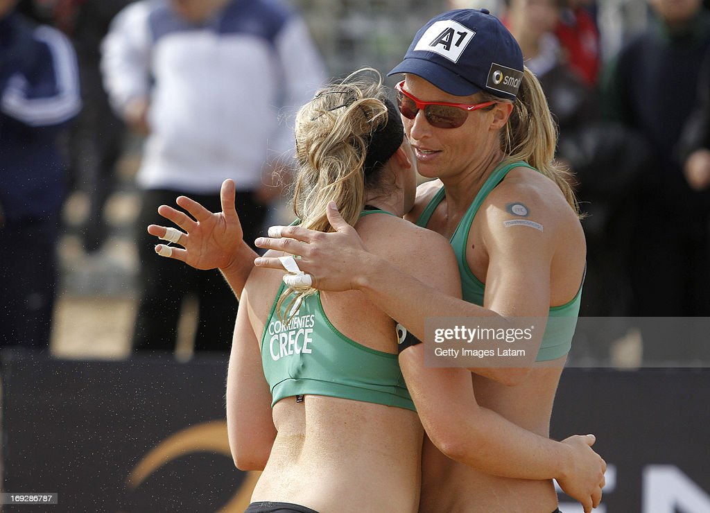 Barbara Hansel and Katharina Schutzenhofer of Austria celebrate during a match between Colombia and Austria as part of day one of Corrientes Grand Slam of FIVB World Tour at Arazaty Beach on May 22, 2013 in Corrientes, Argentina.