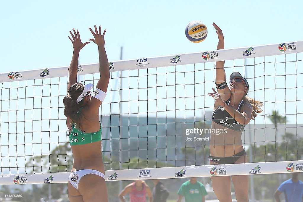 Barbara Hansel of Austria spikes the ball over Liliane Maestrini of Brazil during play at the ASICS World Series of Beach Volleyball - Day 2 on July 23, 2013 in Long Beach, California.