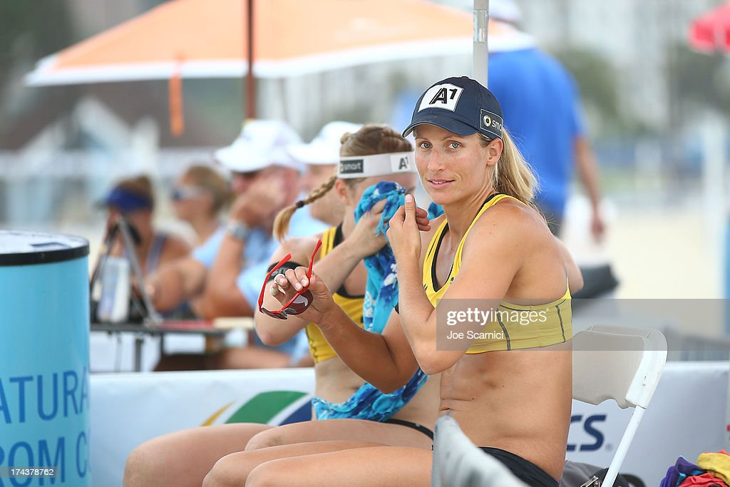 Barbara Hansel rests during a timeout during the round of pool play at the ASICS World Series of Beach Volleyball - Day 3 on July 24, 2013 in Long Beach, California.