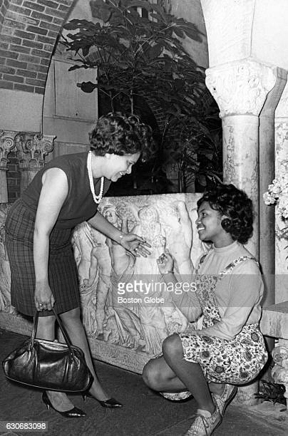 Barbara Johnson left and her daughter Saundra Johnson admire carvings on the walls at the Isabella Stewart Gardner Museum in Boston on May 6 during a...