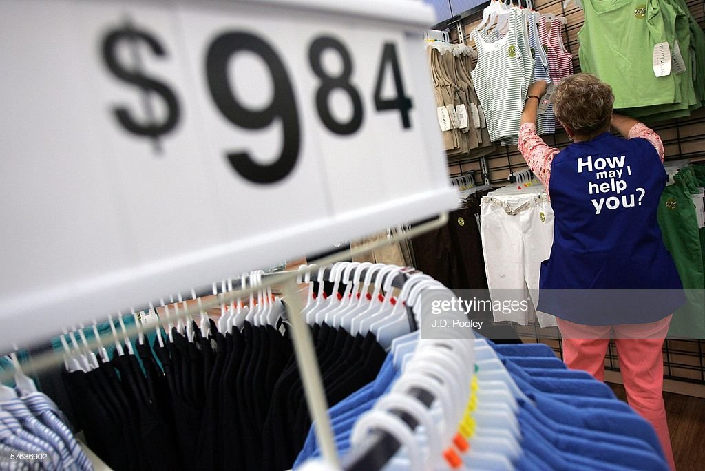 Barbara Kokensparger, who has been working with Wal-Mart for the past 11 years, scans clothing items at the new 2,000 square foot Wal-Mart Supercenter store May 17, 2006 in Bowling Green, Ohio. The new store, one of three new supercenters opening today in Ohio, employs 340 people with 60 percent of those working full-time.
