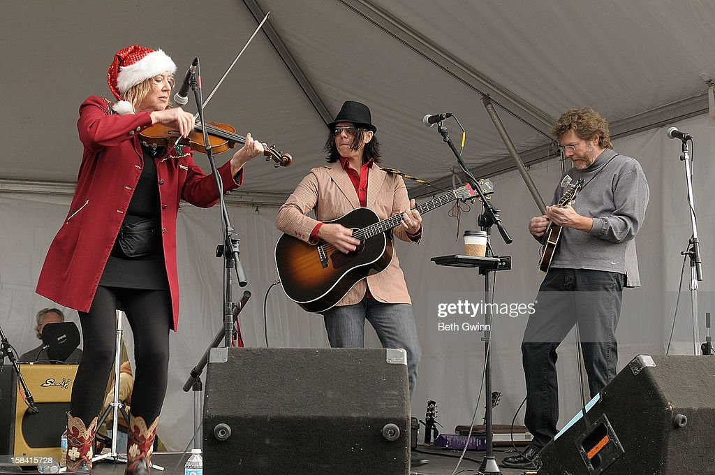 Barbara Lamb, Mike Farris, and <a gi-track='captionPersonalityLinkClicked' href=/galleries/search?phrase=Sam+Bush&family=editorial&specificpeople=1135481 ng-click='$event.stopPropagation()'>Sam Bush</a> performs at the 3rd annual Miracle on Music Row at Music Row Offices on December 15, 2012 in Nashville, Tennessee.