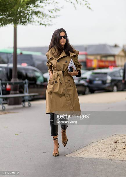 Barbara Martello wearing a beige trench coat outside Loewe on September 30 2016 in Paris France