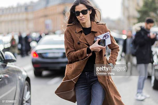 Barbara Martelo wearing a brown coat and grey denim jeans outside Dries van Noten during the Paris Fashion Week Womenswear Fall/Winter 2016/2017 on...