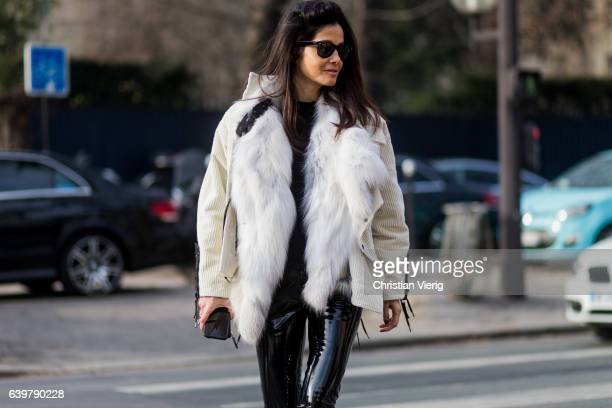Barbara Martelo wearing a white fur jacket and PVC pants outside Dior on January 23 2017 in Paris Canada