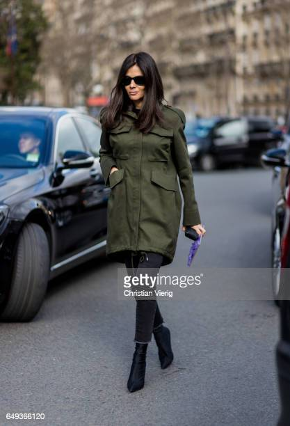 Barbara Martelo wearing an olive coat cropped denim jeans outside Miu Miu on March 7 2017 in Paris France