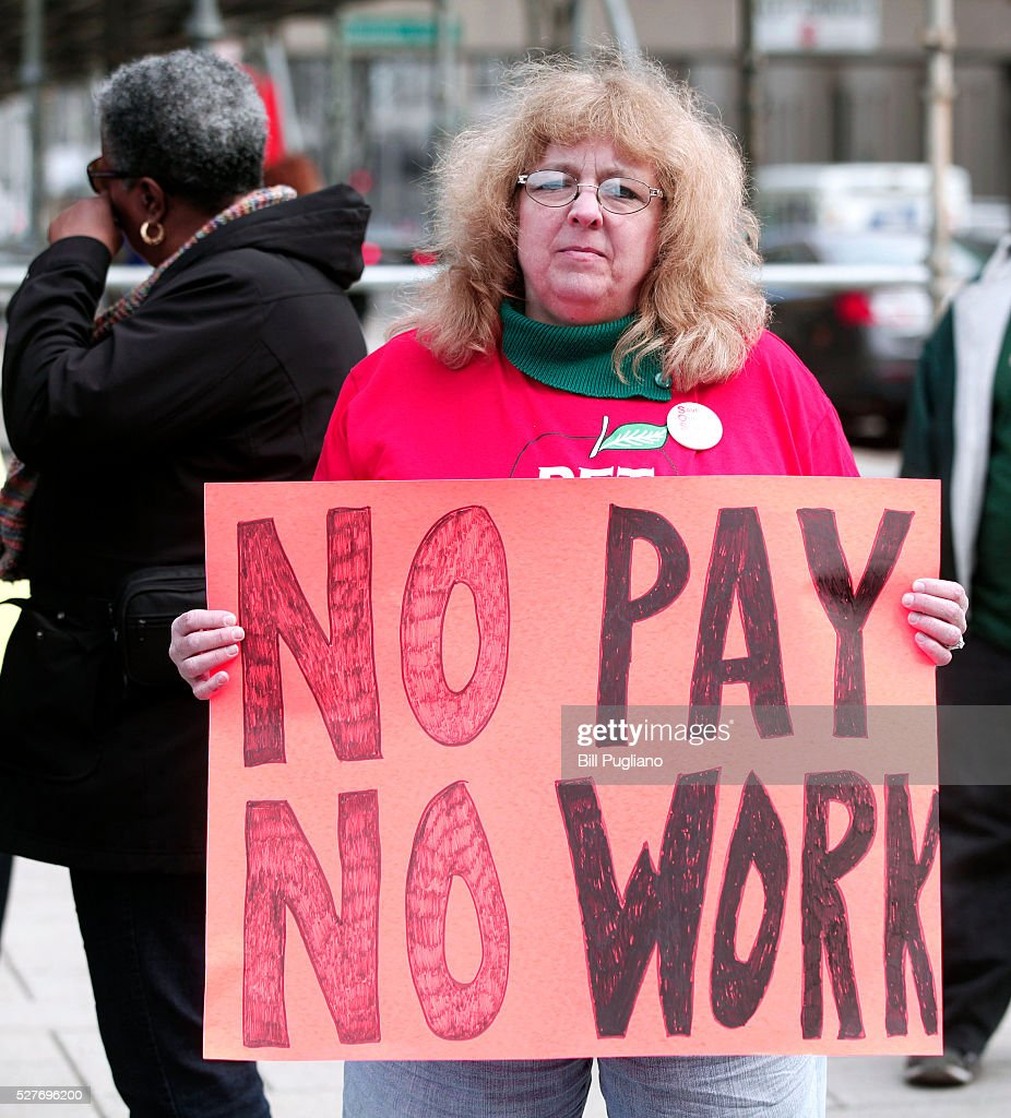Barbara Maxwell of Novi, Michigan, a teacher at Detroit's Earhart Elementary Middle School, participates in a Detroit teachers sick-out, the second in the past two days, and protests in front of Detroit Public Schools headquarters, May 3, 2016 in Detroit, Michigan. The sick-out forced the closing of 94 of 97 Detroit school districts today. The teachers are looking for a guarantee that they will be paid for the work they perform.