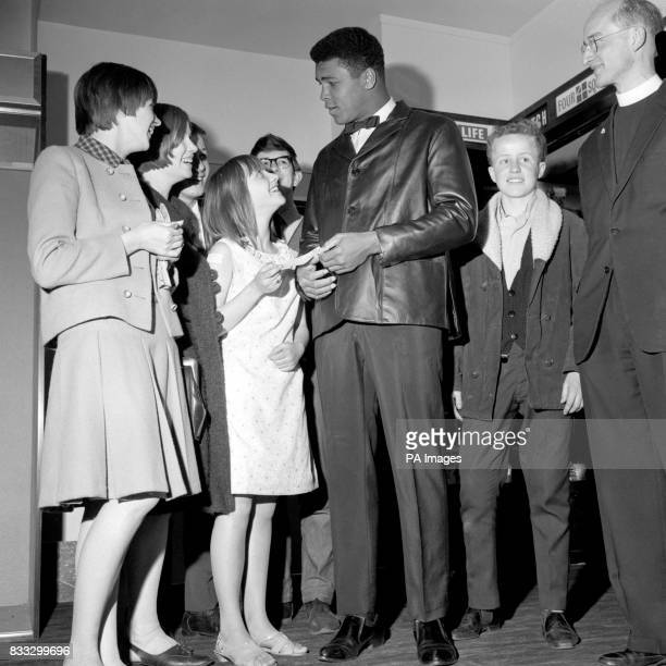 Barbara McCarthy seen with other members of Blackheath Youth Club presents a cheque for 143 to World Heavyweight Champion of the world Muhammad Ali...