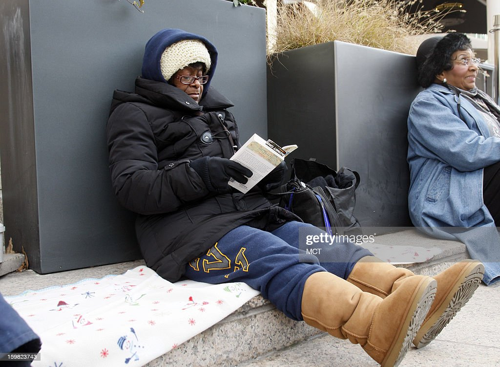 Barbara McNeil, of Oxon Hill, Maryland, reads a book as she waits for the parade to start for the inauguration of U.S. President Barack Obama in Washington, D.C., Monday, January 21, 2013. McNeil got to the parade grounds by 6am.