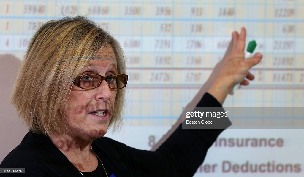 Barbara McNulty points to something on a screen in a classroom at GrotonDunstable High School on May 11 2016 Business and communication teacher...