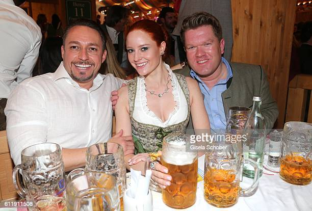 Barbara Meier and her boyfriend Klemens Hallmann and Florian Post during the Oktoberfest at SchuetzenFestzelt /Theresienwiese on October 1 2016 in...