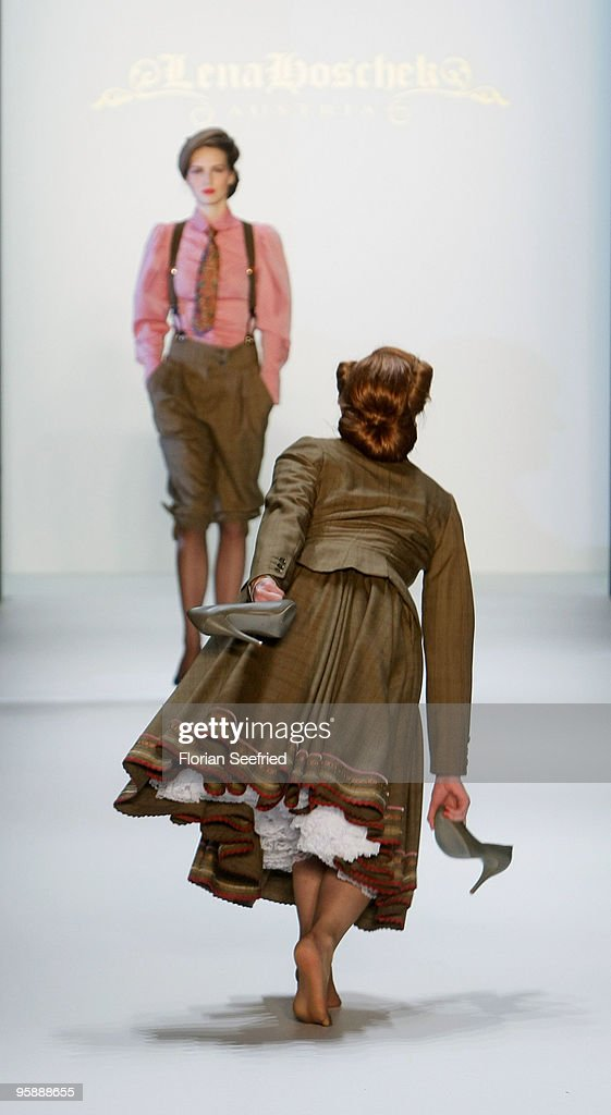 Barbara Meier (R) looses her shoes on the runway at the Lena Hoschek Fashion Show during the Mercedes-Benz Fashion Week Berlin Autumn/Winter 2010 at the Bebelplatz on January 20, 2010 in Berlin, Germany.