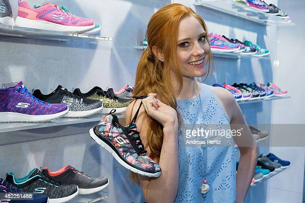 Barbara Meier poses with Skechers shoes during the first day of the GDS Global Destination for Shoes Accessories tradeshow on July 29 2015 in...