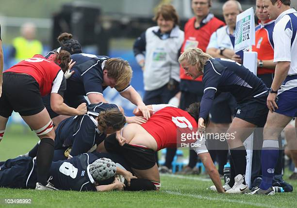 Barbara Mervin of Canada has her shorts pulled down during the Women's Rugby World Cup 2010 Pool C Match between Canada and Scotland at Surrey Sports...