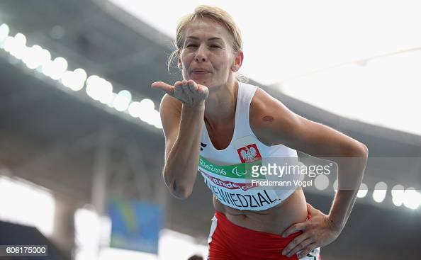 Barbara Niewiedzial of Poland celebrates winning the gold medal after competing in the Women's 1500m T20 on day 9 of the Rio 2016 Paralympic Games at...