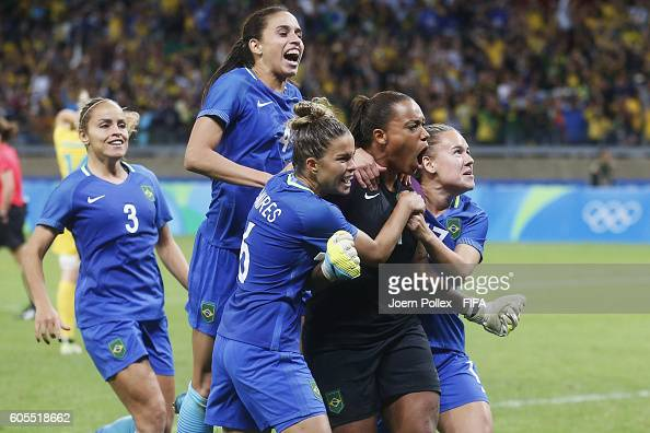 Barbara of Brasil celebrates with her team mates after winning the Women's Quarter Final match between Brasil and Australia on Day 7 of the Rio2016...