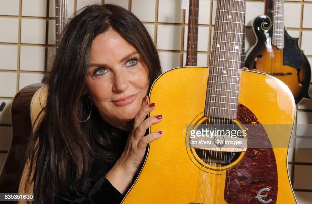 Barbara Orbison holds the new Roy Orbison Limited Edition Epiphone 'Pretty Woman' 12 string acoustic guitar at the Gibson Guitar Studio in London