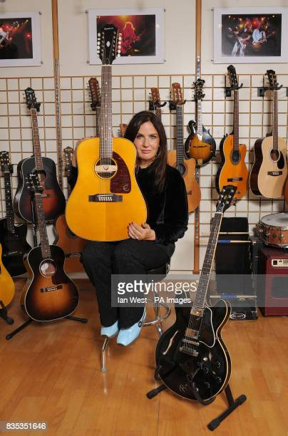 Barbara Orbison holds the new Roy Orbison Limited Edition Epiphone 'Pretty Woman' 12 string acoustic guitar and with the Gibson ES355 Roy Orbison...