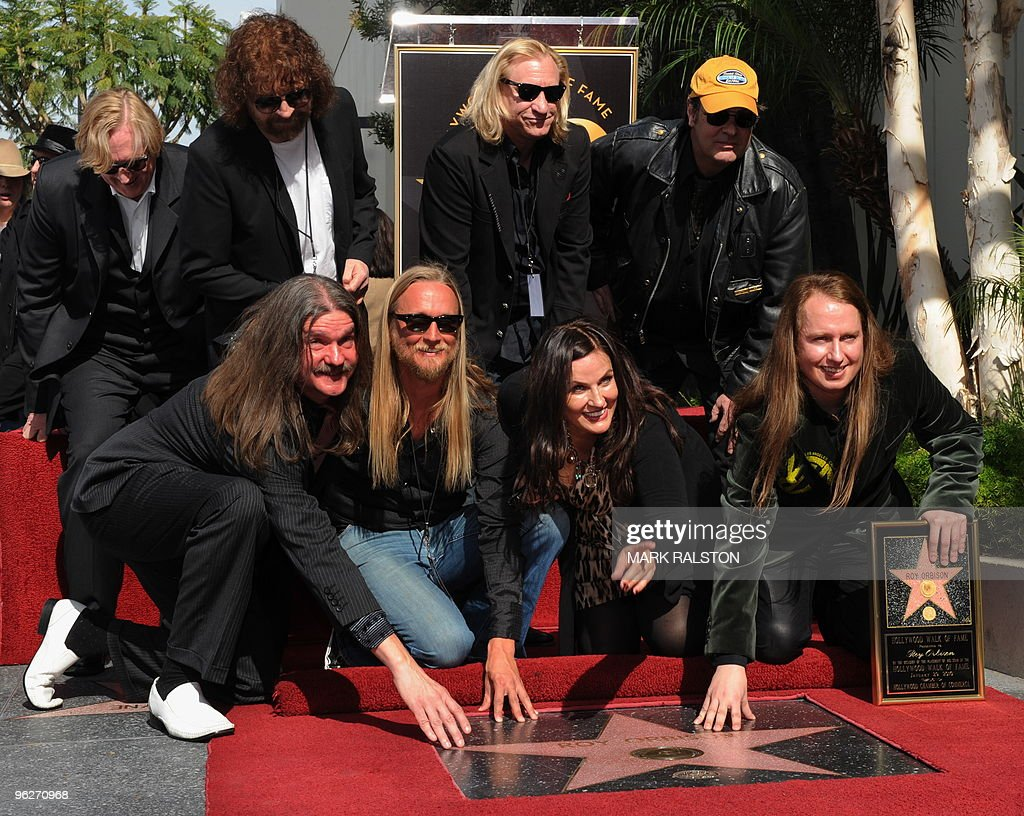 Barbara Orbison (front 2nd R) who is the wife of deceased singer Roy Orbison and his sons Wesley (front L), Alex (front 2nd L) and Roy Orbison Jr (front R) and (L-R back row) T Bone Burnett, Jeff Lynne, Joe Walsh, and actor Dan Aykroyd watch as the star to the music legend is unveilled outside the Capitol Records building at the Hollywood Walk of Fame star ceremony in Hollywood on January 29, 2010. AFP PHOTO/Mark RALSTON