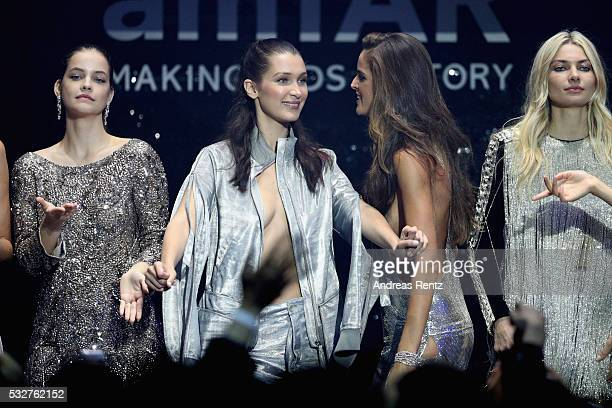 Barbara Palvin Bella Hadid Izabel Goulart and Jessica Hart appear on stage at the amfAR's 23rd Cinema Against AIDS Gala at Hotel du CapEdenRoc on May...