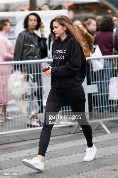 Barbara Palvin model wears a black hoodie 'Public School' black pants white sneakers outside Le Defile L'Oreal Paris as part of Paris Fashion Week...