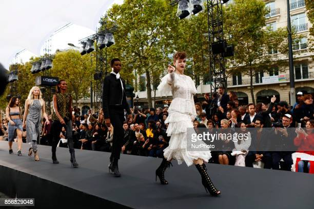 Barbara Palvin walk the runway during the Le Defile L'Oreal Paris show as part of the Paris Fashion Week Womenswear Spring/Summer 2018 at the Champs...