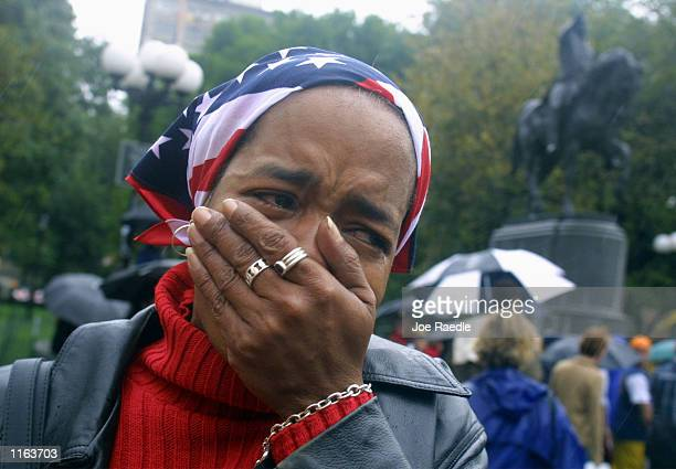 Barbara Richardson cries at a memorial for victims of the World Trade Center disaster September 14 2001 in Union Square Park in New York City The...
