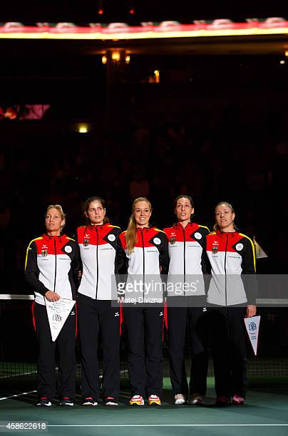 Barbara Rittner Julia Goerges Sabine Lisicki Andrea Petkovic and Angelique Kerber of Germany sing the national anthem before day one of the Fed Cup...