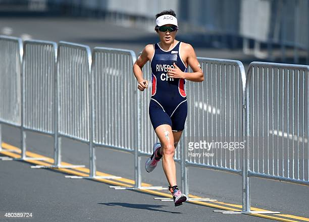 Barbara Riveros of Chile runs to a gold medal in the women's triathlon at Ontario Place during the 2015 Pan American Games for the 2015 Pan American...