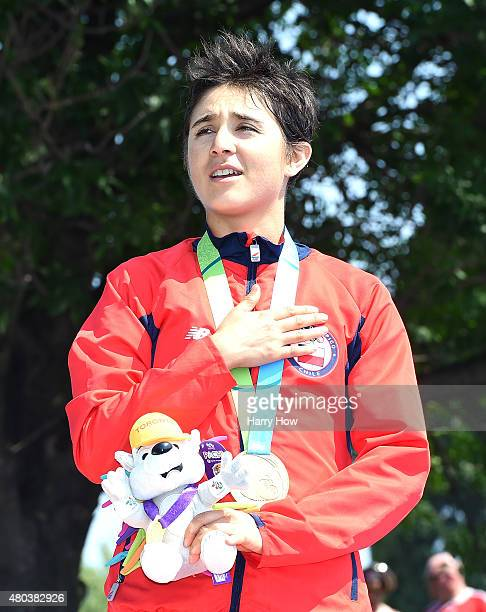 Barbara Riveros of Chile sings the Chilean National Anthem in celebration of her gold medal in the women's triathlon at Ontario Place during the 2015...