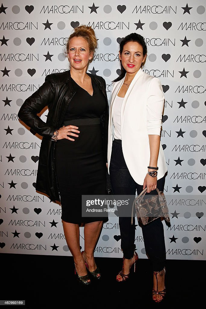 Barbara Schoeneberger and Minu Barati-Fischer attend the Marc Cain show during Mercedes-Benz Fashion Week Autumn/Winter 2014/15 at Brandenburg Gate on January 16, 2014 in Berlin, Germany.