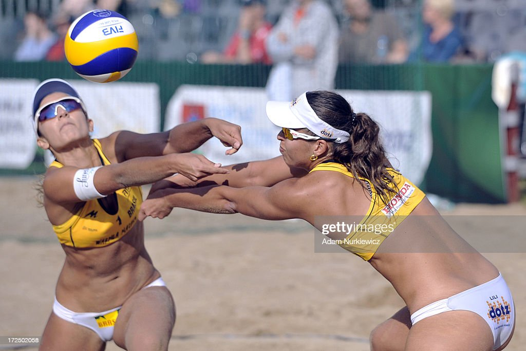 Barbara Seixas De Freitas (L) and Liliane Maestrini (R) of Brazil save the ball during Day 2 of the FIVB World Championships on July 2, 2013 in Stare Jablonki, Poland.