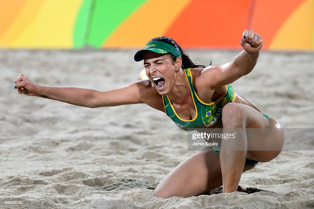 Barbara Seixas De Freitas playing with Agatha Bednarczuk Rippel of Brazil celebrate winning a point during the beach volleyball Women's Semi final against Kerri Walsh Jennings and April Ross of the United States on Day 11 of the Rio 2016 Olympic Games at the Beach Volleyball Arena on August 16, 2016 in Rio de Janeiro, Brazil.