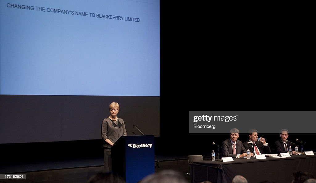 Barbara Stymiest, chairman of BlackBerry, left, speaks while Thorsten Heins, chief executive officer of BlackBerry, second left, listens during the company's annual general meeting in Waterloo, Ontario, Canada, on Tuesday, July 9, 2013. BlackBerrys chances of becoming a viable contender to Apple Inc. and Google Inc. in the smartphone market are dimming amid lackluster demand for its flagship touch-screen device. Photographer: Pawel Dwulit/Bloomberg via Getty Images