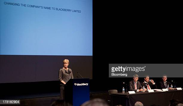 Barbara Stymiest chairman of BlackBerry left speaks while Thorsten Heins chief executive officer of BlackBerry second left listens during the...