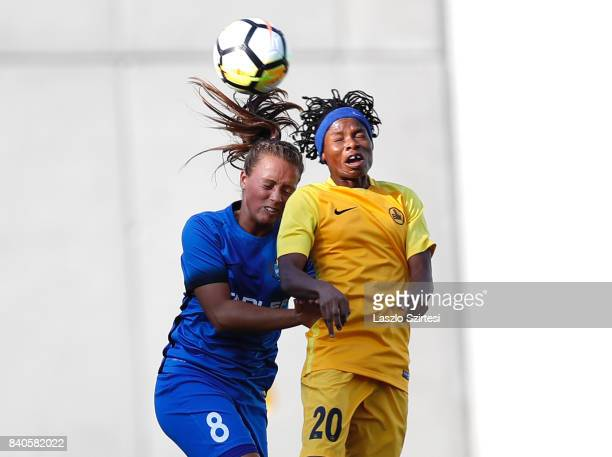 Barbara Toth of MTK Hungaria FC and Charity Adule of WFC BIIKKazygurt in action during the UEFA Women's Champions League Qualifying match between MTK...