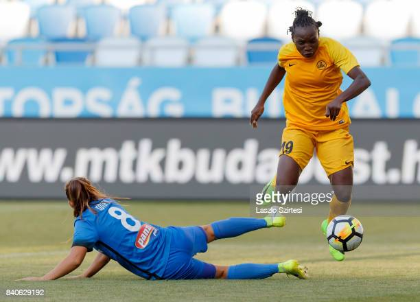 Barbara Toth of MTK Hungaria FC fouls Chinwendu Ihezuo of WFC BIIKKazygurt during the UEFA Women's Champions League Qualifying match between MTK...