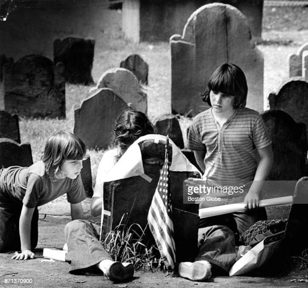 Barbara Vogel of Van Nuys California makes a grave rubbing of Mary Goose's headstone at the Granary Burial Ground on Tremont Street in Boston on Aug...