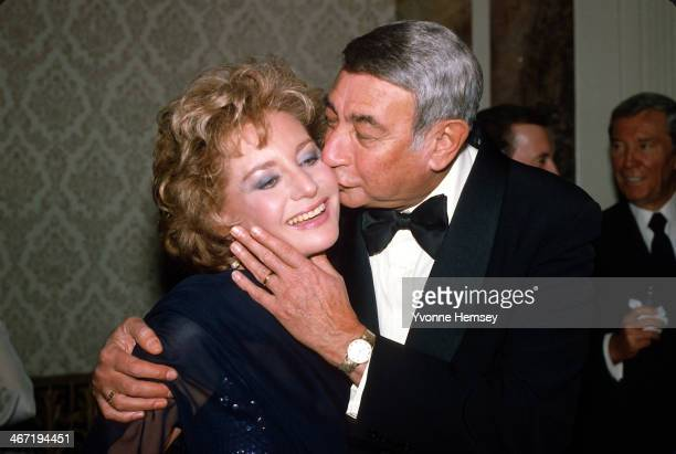 Barbara Walters is kissed by Howard Cosell at Roone Arledge's birthday celebration March 9 1983 in New York City Hemsey/Getty Images