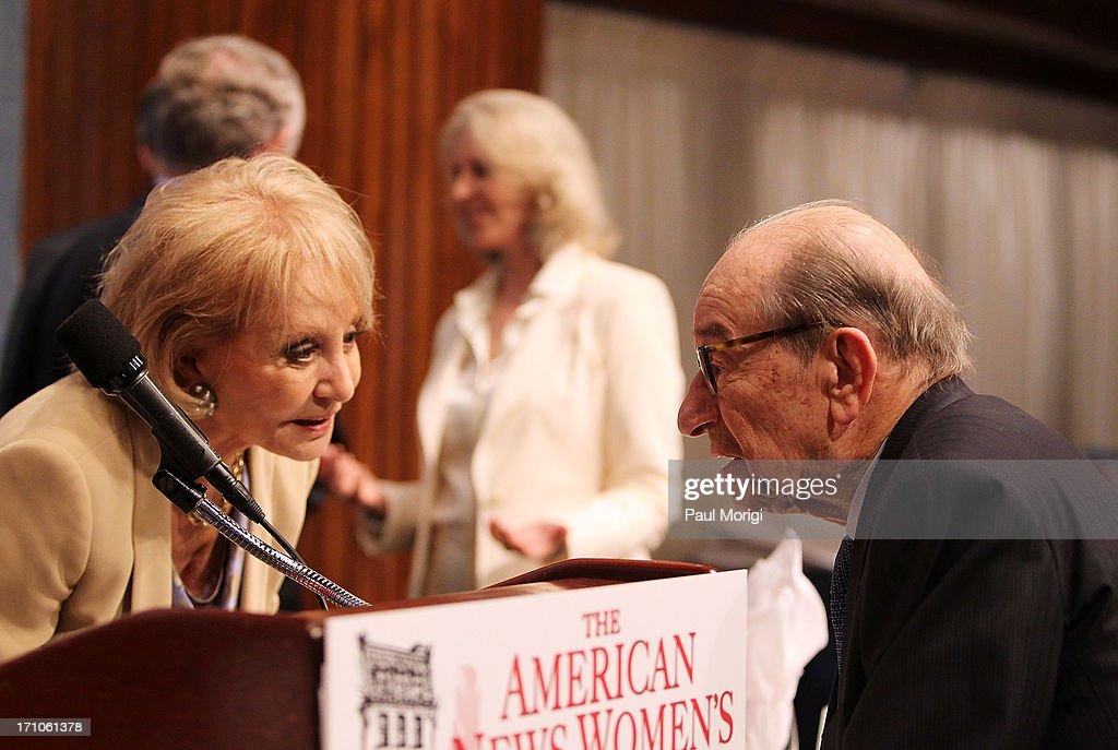 Barbara Walters (L) talks Alan Greenspan at the American News Women's Club 2013 Gala Award luncheon at The National Press Club on June 21, 2013 in Washington, DC.