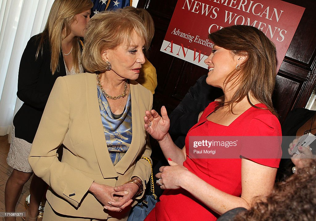 Barbara Walters (L) talks with Norah O'Donnell at the American News Women's Club 2013 Gala Award luncheon at The National Press Club on June 21, 2013 in Washington, DC.