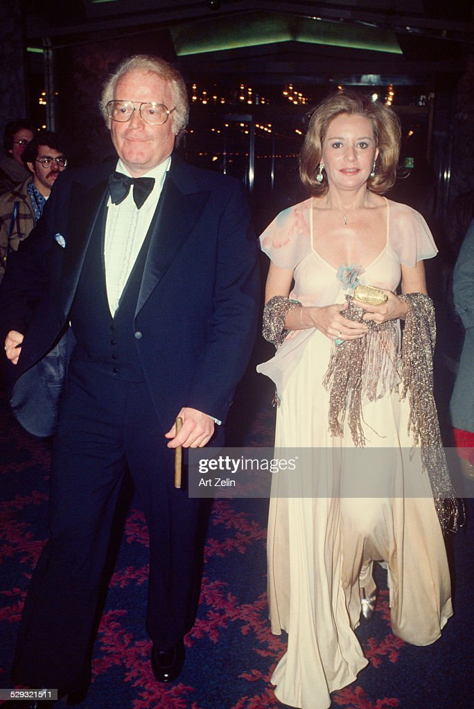 Barbara Walters wearing pink with Roone Arledge at a formal event; circa 1970; New York.