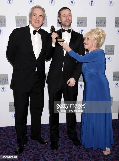 Barbara Windsor and Larry Lamb present Michael Wynne with his Best New Comedy Award for The Priory during the Laurence Olivier Awards at the...