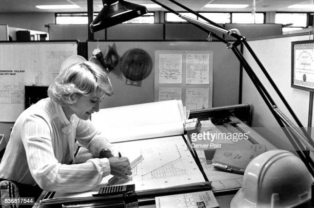 Barbara Woodard checks out a plan in her office and approaches a construction site during an inspection Awaiting her arrival are Mickey Gorton left...